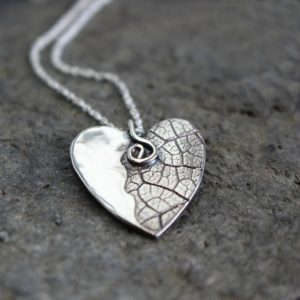 Blinkidees Sterling silver heart pendant with leaf texture on a chain.