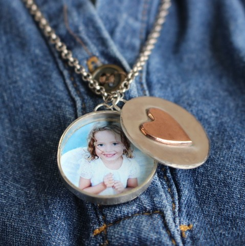 A two-piece sterling silver photo locket with a hidden secret message